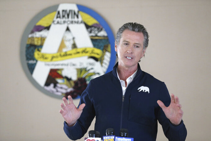 Californian Governor Gavin Newsom talks during a visit to Arvin Veterans Hall in Arvin, Calif. in Kern County on Monday, Feb. 22, 2021, to highlight the state's efforts to administer COVID-19 vaccines quickly and equitably across California. Newsom said more vaccines are headed to California's vast Central Valley, an agricultural region that has been hard hit by the coronavirus. (Alex Horvath/Bakersfield Californian via AP)