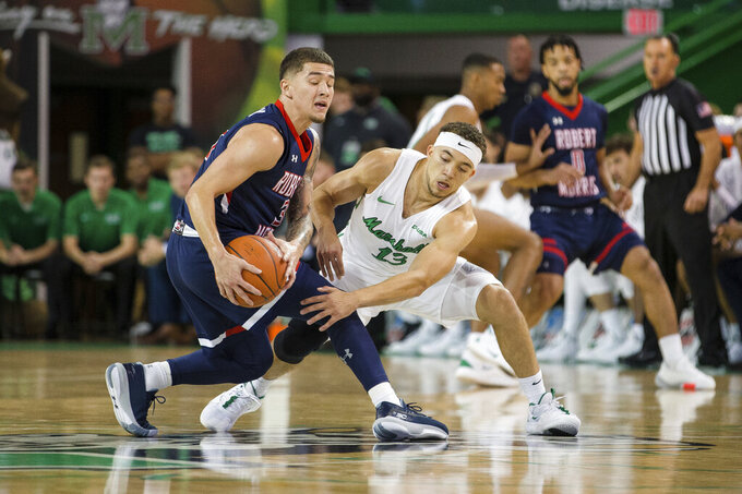 Marshall's Jarrod West (13) attempts to steal the ball from Robert Morris' Dante Treacy (3) during an NCAA college basketball game Thursday, Nov. 7, 2019, in Huntington, W.Va. (Sholten Singer/The Herald-Dispatch via AP)