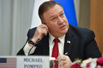 U.S. Secretary of State Mike Pompeo inserts an earphone during a joint news conference with Uzbekistan's Foreign Minister Abdulaziz Kamilov following the talks in Tashkent, Uzbekistan, Monday, Feb. 3, 2020. (AP Photo)