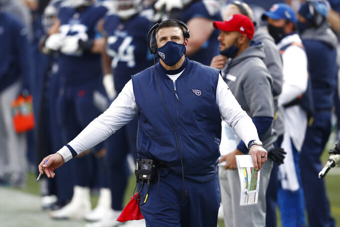 Tennessee Titans head coach Mike Vrabel watches from the sideline in the second half of an NFL wild-card playoff football game against the Baltimore Ravens Sunday, Jan. 10, 2021, in Nashville, Tenn. (AP Photo/Wade Payne)