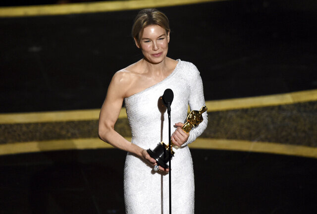 Renee Zellweger accepts the award for best performance by an actress in a leading role for