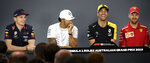 Renault driver Daniel Ricciardo, second right, of Australia jokes with Red Bull driver Max Verstappen, left, of the Netherlands, Mercedes driver Lewis Hamilton of Britain and Ferrari driver Sebastian Vettel, right, of Germany during the drivers press conference ahead of the Australian Formula One Grand Prix in Melbourne, Australia, Thursday, March 14, 2019. The season-opening Australian Grand Prix will be raced here on Sunday, March 17. (AP Photo/Andy Brownbill)