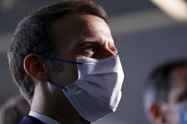 French President Emmanuel Macron looks on as he visits the IMAGINE Institute at the Necker Hospital, Friday Dec. 4, 2020 in Paris. (Thomas Samson, Pool via AP)