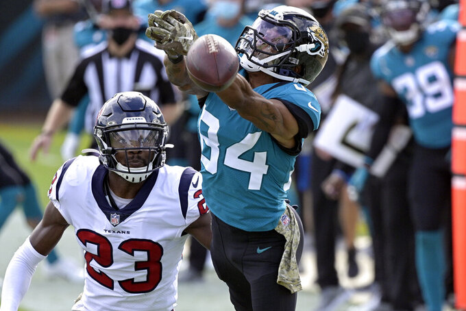 Jacksonville Jaguars wide receiver Keelan Cole Sr. (84) reaches but can't make a reception as he gets in front of Houston Texans safety Eric Murray (23) during the first half of an NFL football game, Sunday, Nov. 8, 2020, in Jacksonville, Fla. (AP Photo/Phelan M. Ebenhack)
