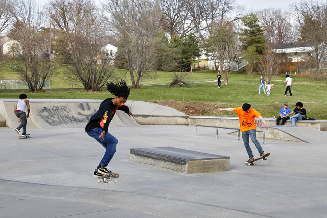 In this April 6, 2020 photo, skateboarders are seen in a park in Omaha, Neb. As most governors have imposed stay-at-home orders that public health officials say are essential to slowing the spread of the new coronavirus, leaders in a handful of states have steadfastly refused to take the action, arguing it's unneeded and potentially harmful. (AP Photo/Nati Harnik)