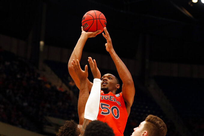 Auburn center Austin Wiley (50) shoots against Saint Louis during the second half of an NCAA college basketball game Saturday, Dec. 14, 2019, in Birmingham, Ala. (AP Photo/Butch Dill)