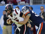 South Carolina's Jake Bentley (19) is sacked by Virginia's Jordan Mack (37) during the second half of the Belk Bowl NCAA college football game in Charlotte, N.C., Saturday, Dec. 29, 2018. (AP Photo/Chuck Burton)