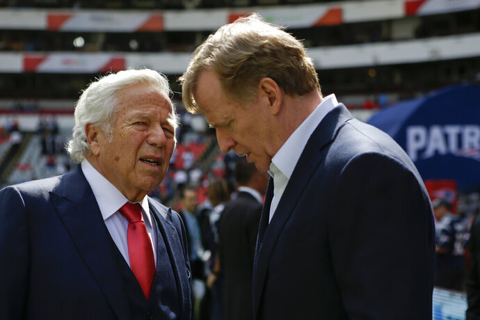 FILE - In this Nov. 19, 2017, file photo, NFL Commissioner Roger Goodell, right, talks with New England Patriots owner Robert Kraft before the Patriots face the Oakland Raiders in an NFL football game in Mexico City. Pending the completion of police investigations in Florida, and likely a league probe as well, Goodell could punish Kraft for being charged with two counts of soliciting a prostitute. The 77-year-old Kraft was twice videotaped in a sex act at a shopping-center massage parlor in Florida, police said Friday, Feb. 22, 2019. (AP Photo/Rebecca Blackwell, File)