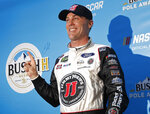 Kevin Harvick poses for photographers after winning the pole position during qualifying for a NASCAR Cup Series auto race at the Las Vegas Motor Speedway, Friday, March 1, 2019, in Las Vegas. (AP Photo/John Locher)