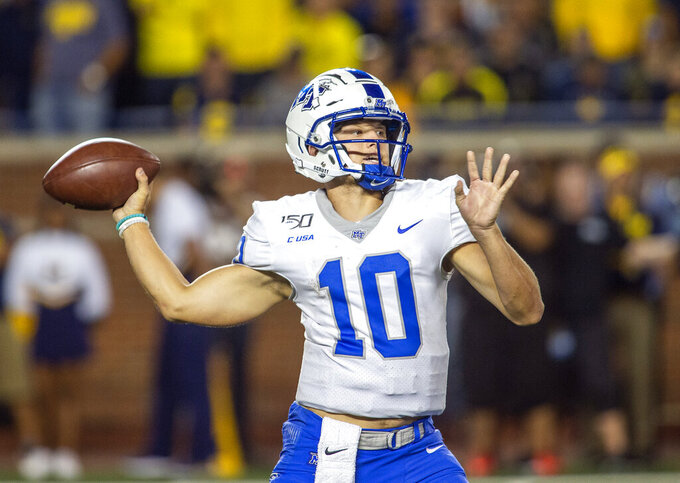 Middle Tennessee quarterback Asher O'Hara throws a pass in the fourth quarter of the team's NCAA football game against Michigan in Ann Arbor, Mich., Saturday, Aug. 31, 2019. Michigan won 40-21. (AP Photo/Tony Ding)