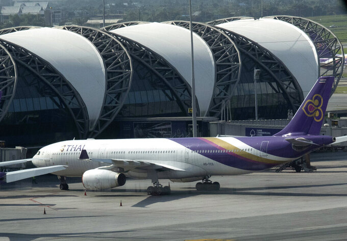 FILE - In this Sept. 14, 2020, file photo, a Thai Airways jet sits on the tarmac at the Suvarnabhumi Airport in Bangkok, Thailand. Creditors of Thai Airways International holding 91.56% of the airline's debt have approved a business reorganization plan, the company announced Wednesday, May 19, 2021 in a filing to the Stock Exchange of Thailand. (AP Photo/Sakchai Lalit, File)