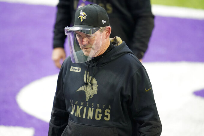 Minnesota Vikings head coach Mike Zimmer walks off the field after an NFL football game against the Detroit Lions, Sunday, Nov. 8, 2020, in Minneapolis. The Vikings won 34-20. (AP Photo/Jim Mone)
