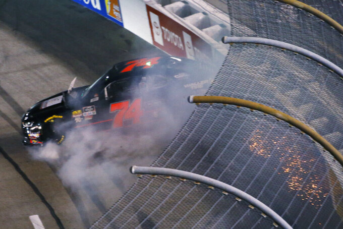 Tyler Matthews (74) hits the wall in Turn 2 during the NASCAR Xfinity auto race at Richmond Raceway in Richmond, Va., Friday, Sept. 20, 2019. (AP Photo/Steve Helber)