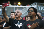 People attend a community memorial service, Wednesday, Aug. 14, 2019, at Southwest University Park, in El Paso, Texas, for the people killed in a mass shooting on Aug. 3. (Briana Sanchez/The El Paso Times via AP)