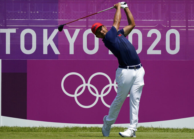 CORRECTS LAST NAME TO SCHAUFFELE FROM SHAUFFELE -  Xander Schauffele of the United States hits a tee shot on the first hole during the final round of the men's golf event at the 2020 Summer Olympics on Sunday, Aug. 1, 2021, in Kawagoe, Japan. (AP Photo/Matt York)