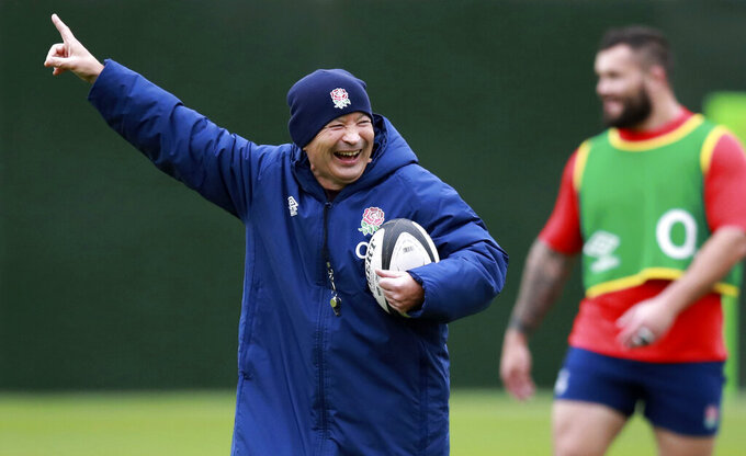 FILE - In this Friday, Oct. 16, 2020 file photo, England's head coach Eddie Jones gestures as he watches his players during an England rugby union team training session at Twickenham Stadium in London. England rugby coach Eddie Jones is isolating after being in contact with one of his assistants who has tested positive for the coronavirus, the team said Wednesday Jan. 20, 2021, in a blow to its preparations for the Six Nations tournament. (Dave Rogers/Pool via AP, File)