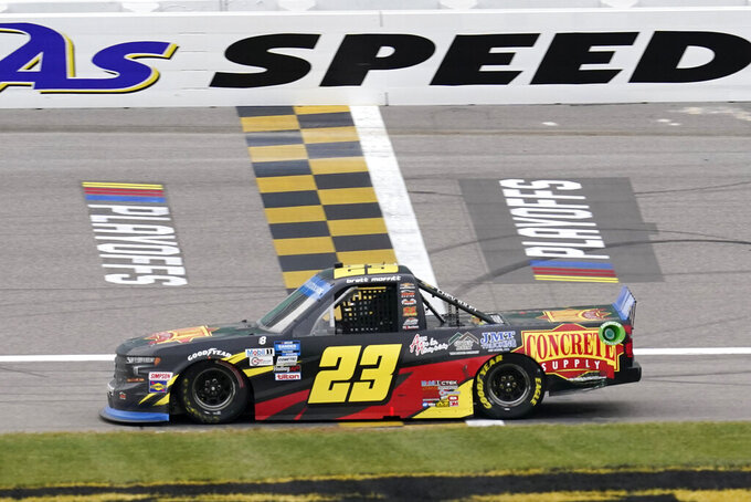 Brett Moffitt (23) crosses the finish line to win a NASCAR Truck Series auto race at Kansas Speedway in Kansas City, Kan., Saturday, Oct. 17, 2020. (AP Photo/Orlin Wagner)