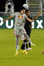 New York Red Bulls forward Brian White, left, and Inter Miami midfielder Victor Ulloa, right, go for the ball during the first half of an MLS match, Wednesday, Sept. 23, 2020, in Fort Lauderdale, Fla.  (AP Photo/Lynne Sladky)
