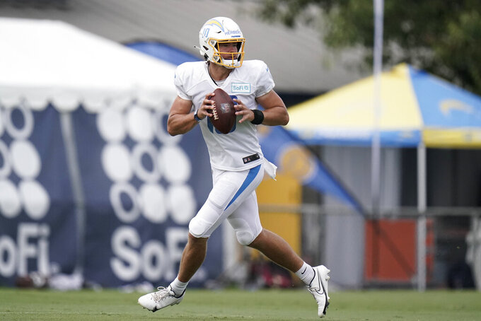 Los Angeles Chargers quarterback Justin Herbert pulls back to throw a pass during an NFL football camp practice, Monday, Aug. 17, 2020, in Costa Mesa, Calif. (AP Photo/Jae C. Hong)