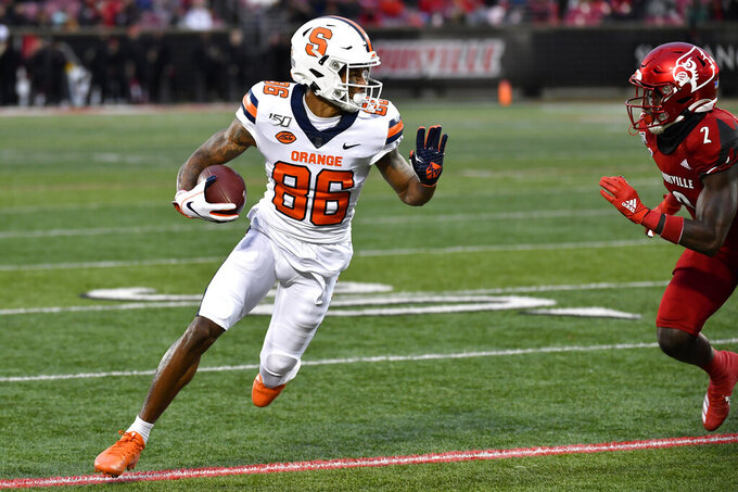Syracuse wide receiver Trishton Jackson (86) attempts to get away from the pursuit of Louisville defensive back Chandler Jones (2) during the first half of an NCAA college football game in Louisville, Ky., Saturday, Nov. 23, 2019. (AP Photo/Timothy D. Easley)