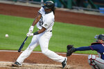 Pittsburgh Pirates' Josh Bell, left, hits a double in front of Minnesota Twins catcher Mitch Garver in the fourth inning of a baseball game, Wednesday, Aug. 5, 2020, in Pittsburgh. (AP Photo/Keith Srakocic)