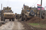 In this frame grab from video, an American military convoy is seen in the village of Khirbet Ammu, east of Qamishli city, Syria, Wednesday, Feb. 12, 2020. Syrian media and activists say a Syrian was killed and another wounded in a rare clash between American troops and a group of government supporters in northeast Syria. (AP Photo)