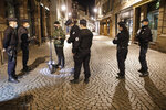 Police patrol the center of the city to enforce the curfew in Strasbourg, eastern France, Saturday, Oct. 24, 2020. The curfew imposed in eight regions of France last week, including Paris and its suburbs, is being extended to 38 more regions and Polynesia. (AP Photo/Jean-Francois Badias)