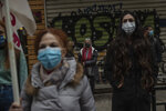 Primary school teachers wearing face masks protest outside Health Ministry demanding more safety measures in schools against the coronavirus pandemic, in Athens, Friday, Jan. 15, 2021. Primary schools and kindergartens reopened this week, but high school lessons are being held online only.Greece's prime minister says the country's retail sector might begin to gradually reopen next week, if the scientists advising the government on the coronavirus pandemic recommend it is safe to do so today. (AP Photo/Petros Giannakouris)