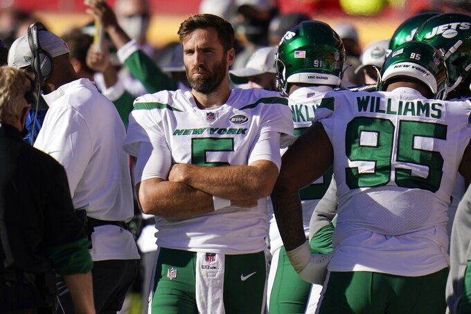 New York Jets' Joe Flacco (5) and Quinnen Williams (95) watch play from the sideline late in the second half of an NFL football game against the Kansas City Chiefs on Sunday, Nov. 1, 2020, in Kansas City, Mo. (AP Photo/Jeff Roberson)