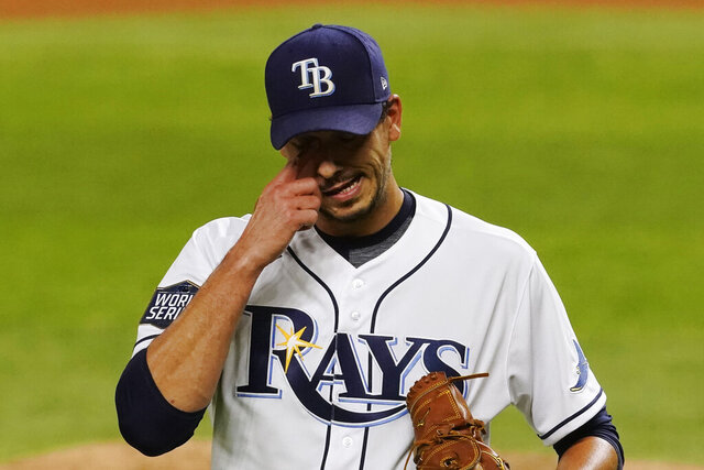 Tampa Bay Rays starting pitcher Charlie Morton reacts after giving up two runs against the Los Angeles Dodgers during the third inning in Game 3 of the baseball World Series Friday, Oct. 23, 2020, in Arlington, Texas. (AP Photo/Tony Gutierrez)