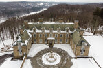 FILE - In this Tuesday, Feb. 23, 2021, file photo, Seven Springs, a property owned by former U.S. President Donald Trump is shown covered in snow in Mount Kisco, N.Y. The estate, 213-acres of land surrounding a Georgian-style mansion, is a subject of two state investigations in New York: a criminal probe by Manhattan District Attorney Cyrus Vance Jr. and a civil inquiry by state Attorney General Letitia James. (AP Photo/John Minchillo, File)
