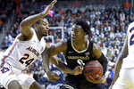 Vanderbilt guard Saben Lee (0) drives past Auburn forward Anfernee McLemore (24) during the first half of an NCAA college basketball game Wednesday, Jan. 8, 2020, in Auburn, Ala. (AP Photo/Julie Bennett)