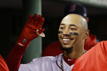 Boston Red Sox's Mookie Betts celebrates in the dugout after his solo home run against the Minnesota Twins during the fourth inning of a baseball game at Fenway Park, Thursday, Sept. 5, 2019, in Boston. (AP Photo/Elise Amendola)