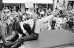 FILE - In this July 31, 1979, file photo, President Jimmy Carter waves from the roof of his car along the parade route through Bardstown, Ky. Carter is sometimes called a better former president than he was president. The backhanded compliment has always rankled Carter allies and, they say, the former president himself. Yet now, 40 years removed from the White House, the most famous resident of Plains, Georgia, is riding a new wave of attention as biographers, filmmakers, climate activists and Carter's fellow Democrats push for a recasting of his presidential legacy. (AP Photo/Bob Daugherty, FIle)