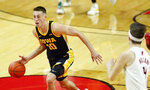 Iowa guard Joe Wieskamp (10) drives to the basket against Rutgers during the first half of an NCAA college basketball game in Piscataway, N.J., Saturday, Jan. 2, 2021. (AP Photo/Noah K. Murray)