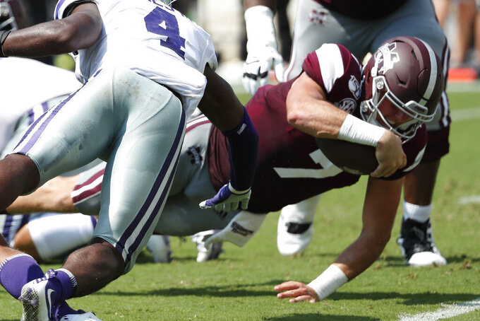 Mississippi State quarterback Tommy Stevens (7) lunges past Kansas State defensive back Wayne Jones (4) for a 1-yard touchdown run during the first half of their NCAA college football game in Starkville, Miss., Saturday, Sept. 14, 2019. (AP Photo/Rogelio V. Solis)