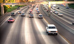 FILE - In this June 17, 1994, file photo, a white Ford Bronco, driven by Al Cowlings carrying O.J. Simpson, is trailed by Los Angeles police cars as it travels on a freeway in Los Angeles. Simpson's ex-wife, Nicole Brown Simpson, and her friend Ron Goldman were found stabbed to death outside her LA home. Simpson is later arrested after a widely televised freeway chase in the vehicle. (AP Photo/Joseph Villarin, File)