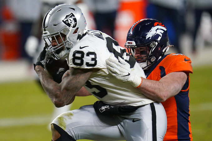 Denver Broncos inside linebacker Josey Jewell (47) tackles Las Vegas Raiders tight end Darren Waller (83) during the second half of an NFL football game, Sunday, Jan. 3, 2021, in Denver. (AP Photo/David Zalubowski)