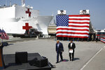President Donald Trump and Defense Secretary Mark Esper arrive to speak in front of the U.S. Navy hospital ship USNS Comfort at Naval Station Norfolk in Norfolk, Va., Saturday, March 28, 2020. The ship is departing for New York to assist hospitals responding to the coronavirus outbreak. (AP Photo/Patrick Semansky)