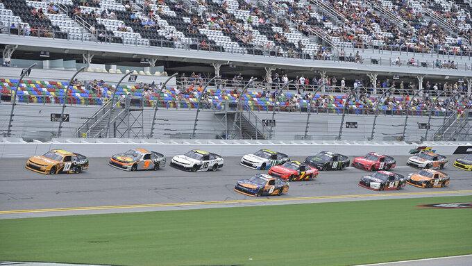 Jeb Burton (10), Noah Gragson (9) and AJ Allmendinger (16) lead the NASCAR Xfinity Series auto race just past the midway point at Daytona International Speedway, Saturday, Aug. 28, 2021, in Daytona Beach, Fla. (AP Photo/Phelan M. Ebenhack)