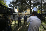 Turan Kislakci, right, head of the Turkish-Arab Media Association, talks to members of the media regarding his friend Saudi writer Jamal Khashoggi, across from the Saudi Arabia consulate in Istanbul, Sunday, Oct. 7, 2018. The Washington Post is reporting that two officials have told it that Turkey believes a prominent Saudi Arabian journalist who contributes to the Post was killed at the Saudi Consulate in Istanbul. Saudi officials have had no immediate comment. The Post says that the anonymous officials with knowledge of the Turkish investigation gave it the information about missing columnist Jamal Khashoggi. (AP Photo/Emrah Gurel)