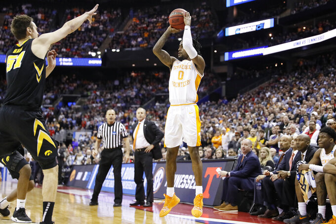 Tennessee's Jordan Bone (0) shoots over Iowa's Nicholas Baer (51) in the second half during a second-round men's college basketball game in the NCAA Tournament, Sunday, March 24, 2019, in Columbus, Ohio. (AP Photo/John Minchillo)