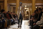 A model wears a creations as part of Versace men's Fall-Winter 2018-19 collection, that was presented in Milan, Italy, Saturday, Jan.13, 2018. (AP Photo/Luca Bruno)