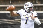 Blake Dever, University of North Alabama Lions quarterback, looks to make a pass during their NCAA football game against Southern Miss at USM in Hattiesburg, Miss., Saturday, Nov. 7, 2020. (Cam Bonelli/Hattiesburg American via AP)