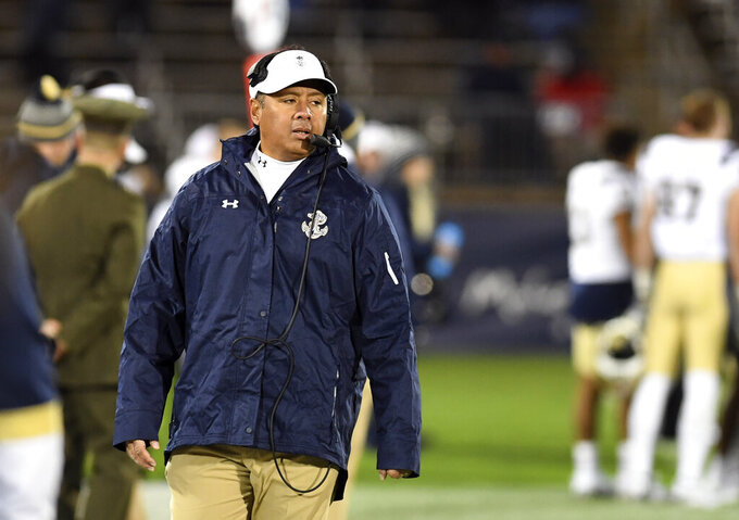 Navy coach Ken Niumatalolo works the sideline during the second half of the team's NCAA college football game against Connecticut on Friday, Nov. 1, 2019, in East Hartford, Conn. (AP Photo/Stephen Dunn)