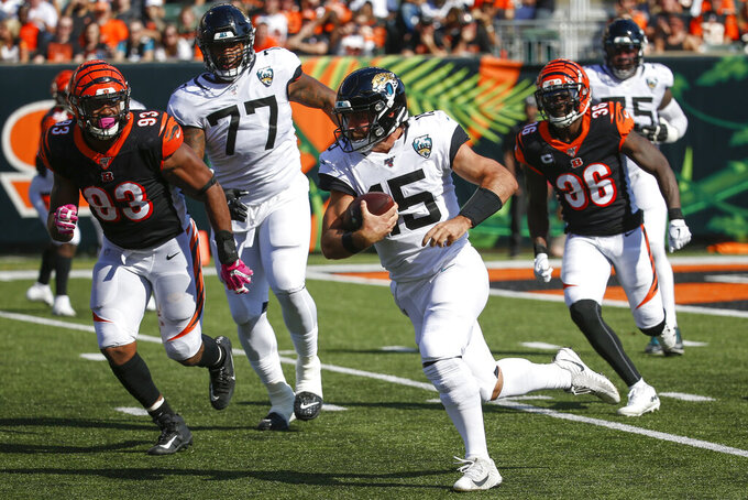 Jacksonville Jaguars quarterback Gardner Minshew (15) runs the ball in the first half of an NFL football game against the Cincinnati Bengals, Sunday, Oct. 20, 2019, in Cincinnati. (AP Photo/Frank Victores)