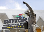 FILE - In this Feb. 16, 2011, file photo, a statue of Dale Earnhardt rises above an entrance at Daytona International Speedway in Daytona Beach, Fla. On the cusp of a national popularity explosion, NASCAR never stopped after the deaths of Adam Petty, Kenny Irwin Jr. and Tony Roper. But losing Earnhardt forced the stock car series to confront safety issues it had been slow to even acknowledge, let alone address. The dramatic upgrades have saved multiple lives — NASCAR has not suffered a racing death in its three national series since — and are the hallmark of Earnhardt's legacy. (AP Photo/Lynne Sladky, File)
