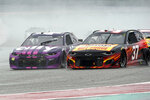 Alex Bowman (48) and Ryan Preece (37) race into Turn 13 during the NASCAR Cup Series auto race at the Circuit of the Americas in Austin, Texas, Sunday, May 23, 2021. (AP Photo/Chuck Burton)