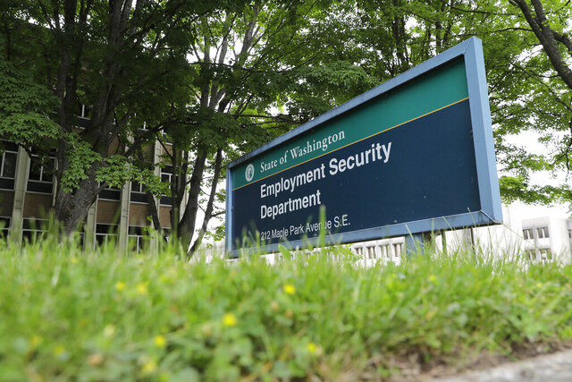 This photo shows a sign at the headquarters for Washington state's Employment Security Department Tuesday, May 26, 2020, at the Capitol in Olympia, Wash. Washington state's rush to get unemployment benefits to residents who lost jobs due to the coronavirus outbreak left it vulnerable to criminals who made off with hundreds of millions of dollars in fraudulent claims. (AP Photo/Ted S. Warren)