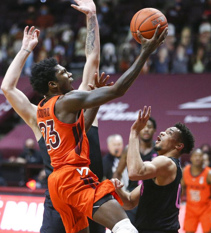 Virginia Tech's Tyrece Radford (23) drives towards the basket during the first half of an NCAA college basketball game against Penn State, Tuesday, Dec. 8, 2020 in Blacksburg Va. (Matt Gentry/The Roanoke Times via AP, Pool)